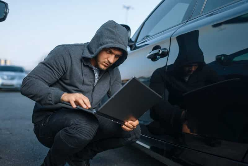 man hacking into a business WiFi from the parking lot